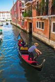 Gondolier drive gondola — Stock Photo