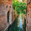 Narrow canal among old colorful brick houses in Venice — Stock Photo