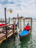 Gondolas moored — Stock Photo