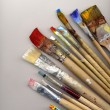 Royalty-Free Stock Photo: Paint brushes lying on watercolor paper