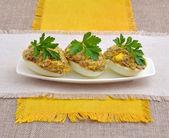 The stuffed eggs with mushroom on yellow napkin — Stock Photo