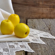 Still life with yellow apples on old board. — Stock Photo