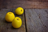 Still life with yellow apples on an old board. — Stock Photo