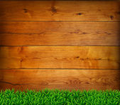 Background from oak boards with green grass. — Vetor de Stock