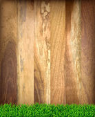 Wooden boards with green grass. — Stockvektor