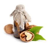 Walnut with pharmaceutical bottle isolated — Stock Photo