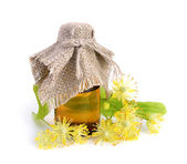 Linden flowers with pharmaceutical bottle — Stock Photo