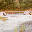Stock Photo: Canoe tent camp at Yukon River in taiga wilderness