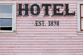 Painted pink historic hotel wooden facade siding — Stock Photo