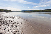 Gravel and mud at Yukon River near Dawson City — Stock Photo