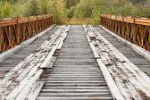Old rotten abandoned bridge leading to nowhere — Stock Photo