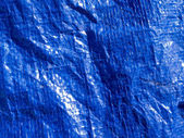 Blue woven plastic tarp background texture pattern — Stock Photo