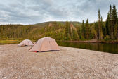 Tents at river in remote Yukon taiga wilderness — Stock Photo