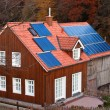 House with solar panels sun heating system on roof — Stock Photo #18155387