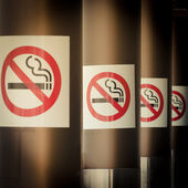 Mobile photography toned row of No Smoking signs — Stock Photo