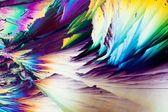 Cristaux d'acide benzoïque en lumière polarisée — Photo