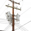 Utility pole with power cables and transformers — Stock Photo #21691039
