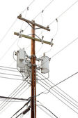 Utility pole with power cables and transformers — Stock Photo