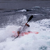 Kayaker in white water paddling breaking waves — Stock Photo