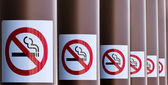 Row of No Smoking signs on series of columns — Stock Photo