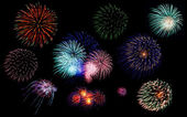 Colorful fireworks of various colors in night sky — Stock Photo