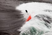 Kayaker in white water paddling breaking waves — Stock Photo