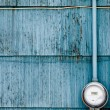 Smart grid power supply meter on grungy blue wall - Stock Photo
