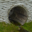 Storm culvert drainage pipe concrete revetment - Stock Photo