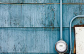 Smart grid power supply meter on grungy blue wall — Stock Photo