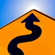 Wavy arrow on road sign pointing up for success — Stock Photo #25184245