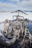 Bizarre burnt out snowmobile on Yukon lake Canada — Stock Photo