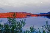 Evening sun glow on calm Twin Lakes Yukon Canada — Stock Photo