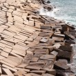 Concrete blocks forming protective coastal seawall — Stock Photo