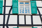 Shuttered window in a German timber frame house — Stock Photo