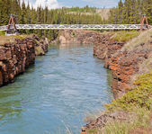 Swing bridge across Miles Canyon of Yukon River — Stock Photo