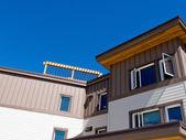 Timber clad condo building exterior upper storey — Stock Photo