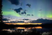 Midnight summer Northern lights Aurora borealis — 图库照片