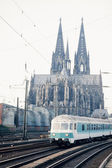 Train passing Cologne Cathedral Germany Europe — Stock Photo