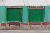 Two green shuttered outside loading gate ramps — Stock Photo