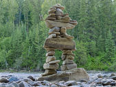 Large stacked stones Inuksuk cairn trail marker — Stock Photo