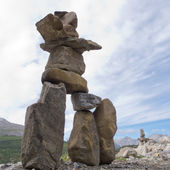 Inuksuk large stacked stones cairn trail marker — Stock Photo