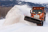 Snow plough clearing road in winter storm blizzard — Stock Photo
