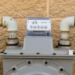 Stock Photo: Outside wall natural gas meter dial display detail