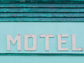 Painted blue-green historic motel facade siding — 图库照片