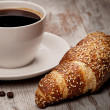Cup of black coffee and croissant — Stock Photo #15734927