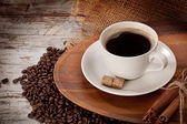 Cup of coofe on wooden tray — Stock Photo