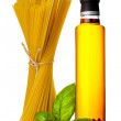 Stock Photo: Pasta with basil chili pepper and spicy olive oil on white backg