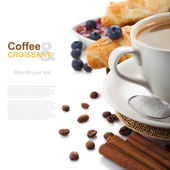 Coffee with croissants and blueberries on white background — Stock Photo