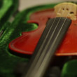 Violin in green case - Stock Photo