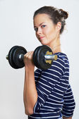 Girl with dumbbell — Stock Photo